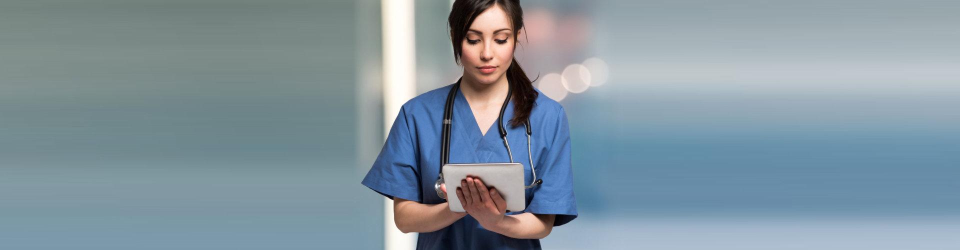 nurse using an ipad